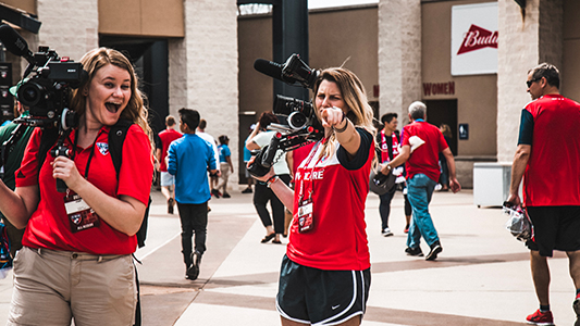 Mallorie Lough (right) with another FC Dallas multimedia worker