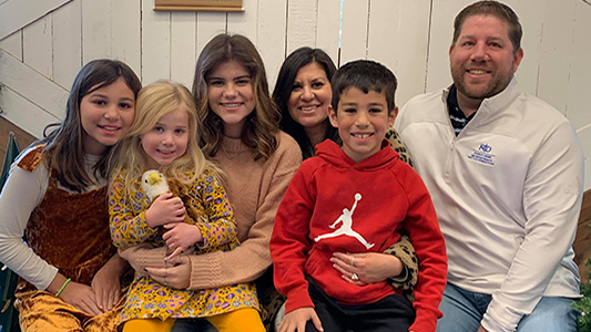 Robert with wife, Haley, and their four children